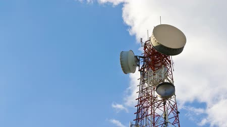 dish : time lapse antenna communication tower and blue sky