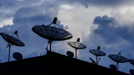 telecoms : Time Lapse Silhouette Satellite Dish And Sky Background Stock Footage