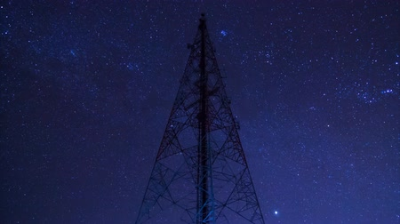 irradiar : time lapse big communication tower and beautiful starry movement in the night sky