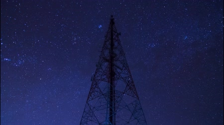 telekomünikasyon : time lapse big communication tower and beautiful starry movement in the night sky