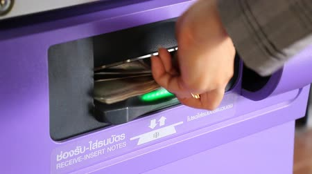 payment : Woman Use Automatic Payment Machine And Receive Change Money Stock Footage