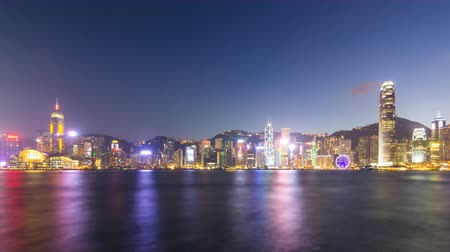 urban skyline : time lapse day to night hong kong cityscape victoria harbour and symphony of light (miniature) Stock Footage