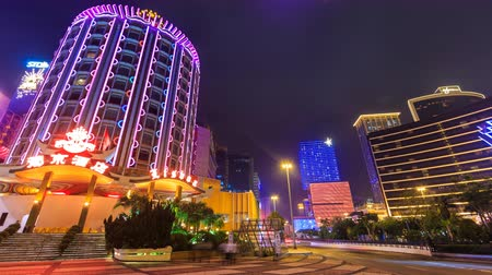 portugese : MACAU - MAY 10 2016 : Time Lapse Night Cityscape Casino And Hotel Modern Building Landmark Entertainment Travel And Economy Zone Of Macau Peninsula a Former Portugese Colonial, Macau China 2016