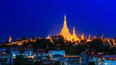 пагода : Shwedagon Golden Pagoda Outstanding Above Yangon Cityscape Day To Night Time Lapse Of Yangon City Myanmar (pan leaf)