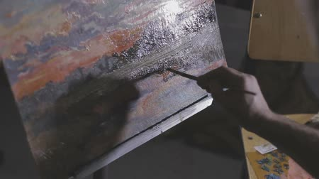 canvas : The artist paints a painting in the studio