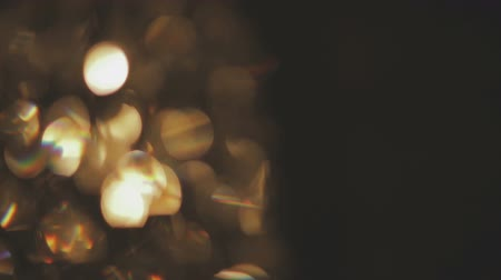 slowing : Moving bokeh lights - abstract animation for background - circles of light crossing the frame form left to right - white lights and pastel colors - animation progressively blurs and slows down. Stock Footage