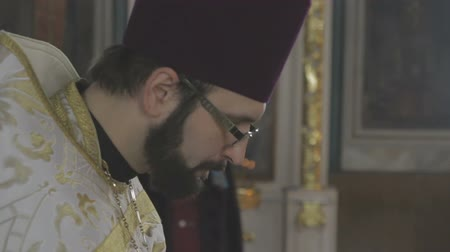 sacramental : A priest in the church reads a prayer Stock Footage