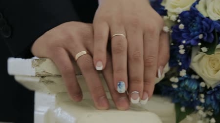 two hearts : Young people hold on and caress their hands Stock Footage