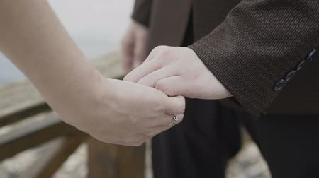 dusk : Hands of lovers who caress each other Stock Footage