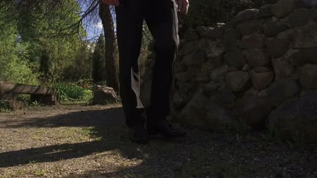 legs only : A man in a suit walks along the sandy land Stock Footage