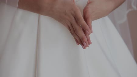 two hearts : Hands of a woman in a white dress Stock Footage