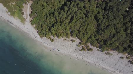 fish eye : Flight over the wild beach. Mountains and cliffs Stock Footage