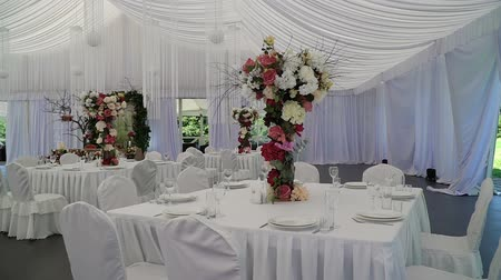 marquee : Interior of a wedding hall decoration ready for guests.Beautiful room for ceremonies and weddings.Wedding concept.Luxury stylish wedding reception purple decorations expensive hall.Wedding decor