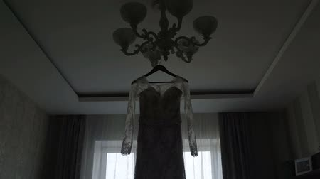 ballroom : wedding dress hanging in front of the window