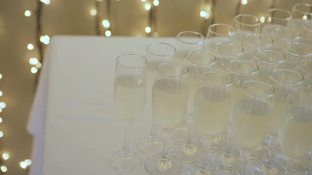 champagne flute : Many glasses of champagne on the table