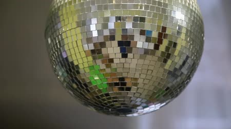 christmas background : Mirror club ball with light reflections and camera movement.