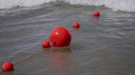 lifebuoy : Buoys in sea water on Adriatic sea coast in Slovenia near the town of Piran.
