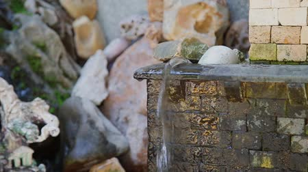 zöld fű : Small artificial fountain with clear water.