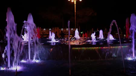 wrocław : Colorful musical fountain at night, shimmering in different colors.