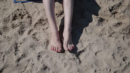 alluring : Beautiful woman feet on sand.