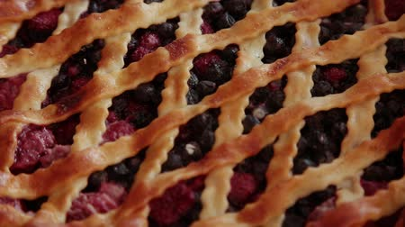 dortík : Berry cake made by own hands on a wooden background.