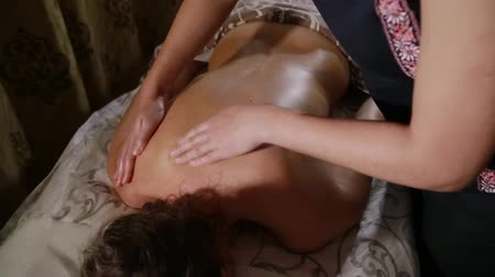 masaż twarzy : Girl doing massage to the woman in the spa salon. Healthy lifestyle concept.