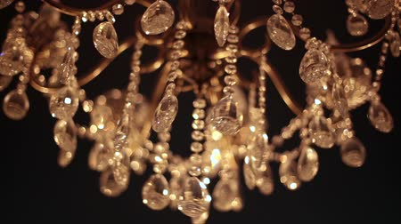 hang : Crystal Chandelier. Close up on the crystal of a contemporary chandelier Stock Footage