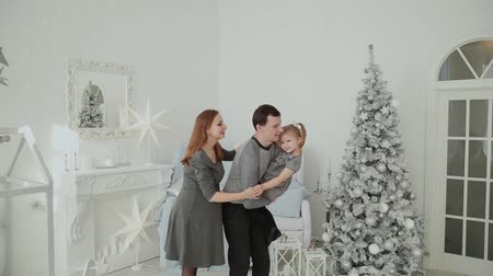 very : Very happy family is laughing and playing in the Christmas room. Stock Footage