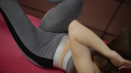 fitness tracker : Very beautiful fitness woman trains press on the floor in the gym. Stock Footage