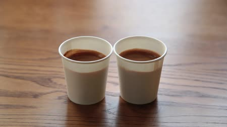 kávové zrno : Two cups of strong espresso on a wooden table.