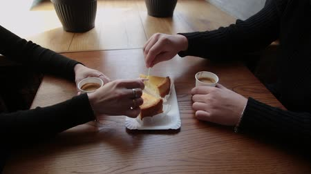 pastry : Love couple sitting in a cafe eating dessert drinking coffee and looking at each other.