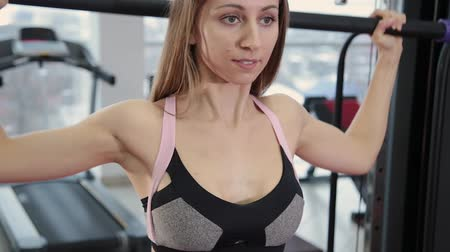 shaping : Beautiful athletic young girl exercises with gymnastic stick in the gym.