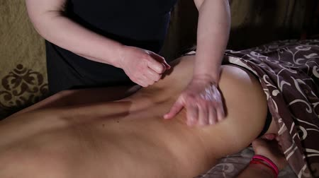 kap : Very beautiful girl gets a back massage in the spa salon.