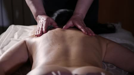 kadınlık : Very beautiful girl gets a back massage in the spa salon.