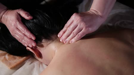 kap : Very beautiful girl gets a head massage in the spa salon.