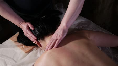 masszőr : Very beautiful girl gets a head massage in the spa salon.