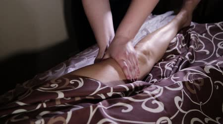kap : Very beautiful girl gets a foot massage in the spa salon. Stock mozgókép