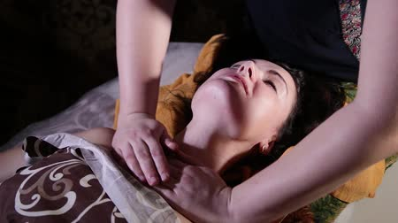 kap : Very beautiful girl gets a neck massage in the spa salon. Stock mozgókép