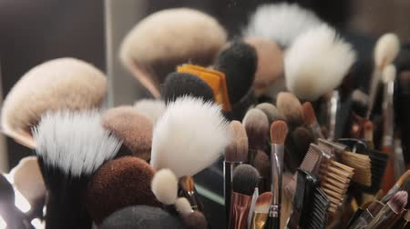 dressing room : Set of brushes for make-up on table in dressing room. Fashion industry. Fashion show backstage.