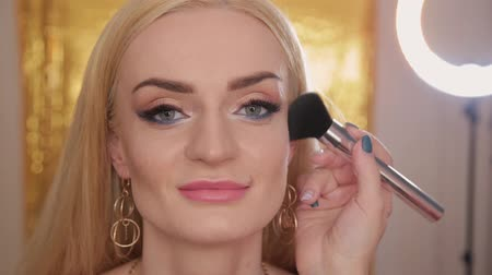 very : Professional makeup artist makes makeup a very beautiful woman. Stock Footage