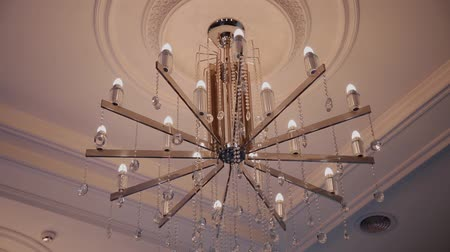 hang gliding : Big beautiful shiny chandelier in the mall.