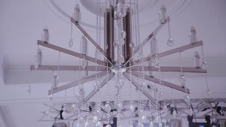 дорогой : Big beautiful shiny chandelier in the mall.