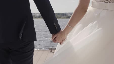 dnes : Marry Me Today And Everyday. Newlywed Couple Holding Hands, Shot In Slow Motion.
