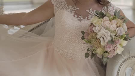 traditional ceremony : Bride in lace dress holding beautiful white wedding flowers bouquet.