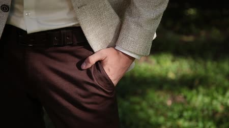 meteliksiz : Very solid businessman holds his hand in his pocket.