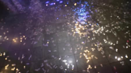 after school : Confetti on the floor in a nightclub. Out of focus
