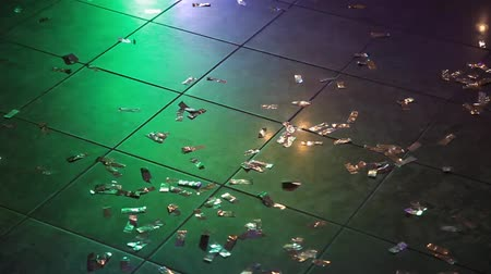 low angle shot : Confetti on the floor in a nightclub.