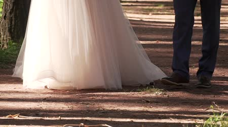trouwen : Marry Me Today And Everyday. Newlywed Couple Holding Hands, Shot In Slow Motion.