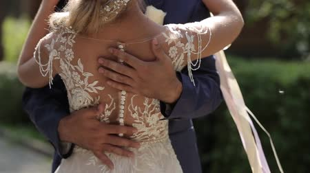 sposini : Marry Me Today And Everyday. Newlywed Couple Holding Hands, Shot In Slow Motion.