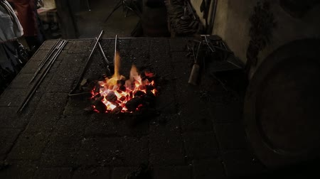 heating up metal : A small fire in the furnace forge.